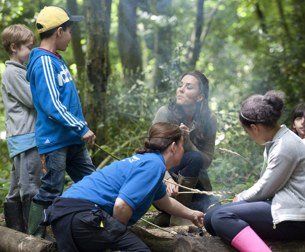 Kate Middleton visited with children from Expanding Horizons primary school outdoor camp.
