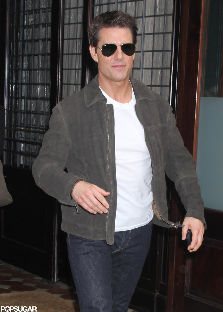 Tom Cruise walked out of a building and headed for the car.