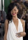 Rihanna wore her oversized rings side by side with a low-cut white dress at the Battleship premiere.