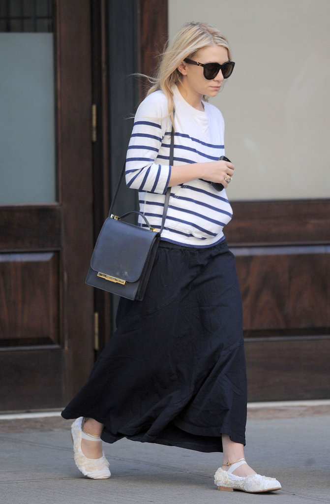 Ashley Olsen made adopting a seasonal spin effortless, adding a classic striped top to a black maxi.