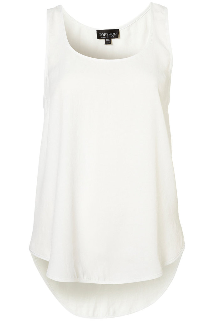 This is the quintessential sporty white tank top. No matter how you spin it, this wardrobe staple will go perfectly with everything from printed silky pants to pleated skirts to denim shorts. Topshop Racer Back Vest ($52)