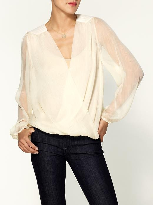 For a more dressed-up cocktail hour, this shade of ivory will show off a well-earned tan. Tinley Road Pretty Shoulder Cross Front Blouse ($59)
