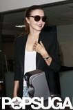 Miranda Kerr smiled as she walked towards her gate at LAX.