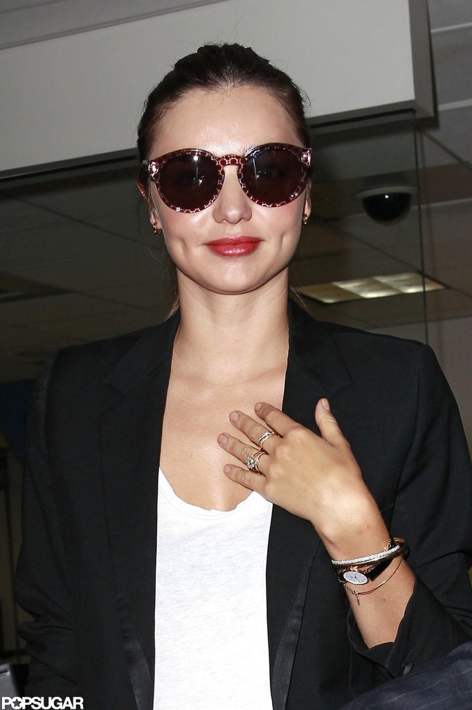 Miranda Kerr kept her hair pulled back as her traveling continued.