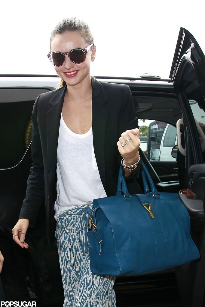 Miranda Kerr arrived at LAX airport for a flight.
