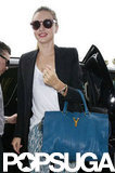 Miranda Kerr carried her bag as she stepped out of the car.