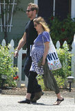 Pregnant Drew Barrymore took a walk on her honeymoon in Montecito, CA, with new husband Will Kopelman in June.