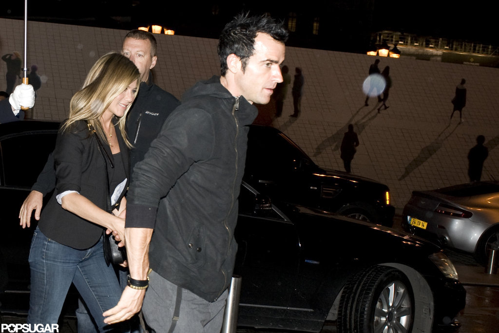 Jennifer Aniston and Justin Theroux held hands as they went out for a meal in Paris.