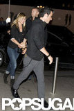 Justin Theroux held Jennifer Aniston's hand as the two walked together in Paris.