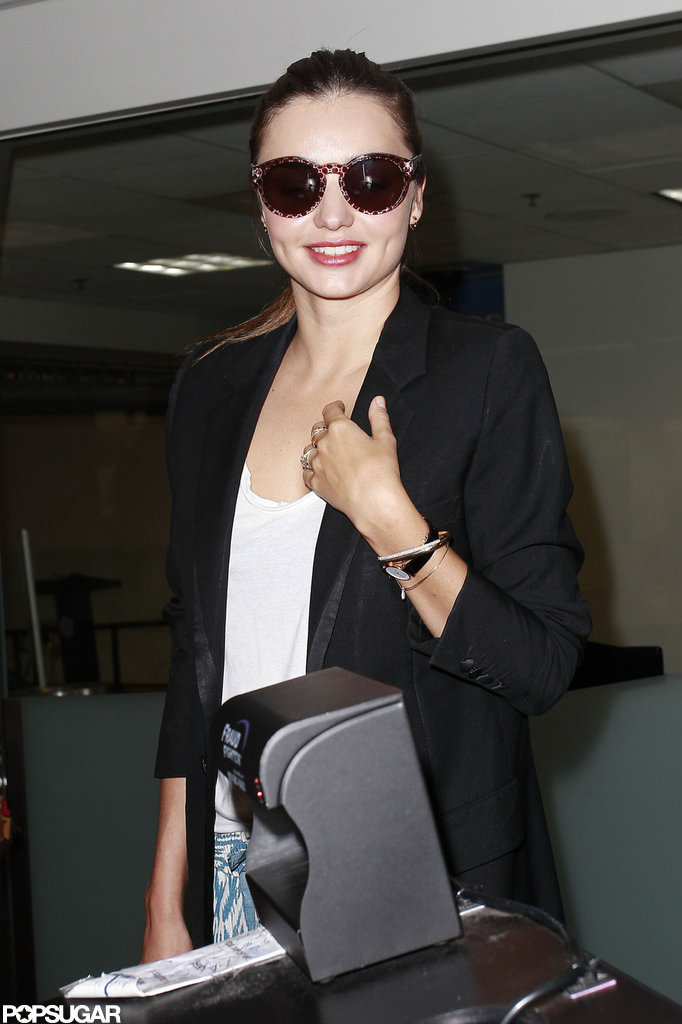 Miranda Kerr smiled for the camera at LAX.
