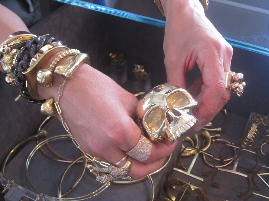Jennifer Fisher shows off one of the gilded skulls in her collection.