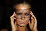 An oldie but a goodie from 2011's Epsom Day races, if anyone can pull off a netted face mask, it's Lara.