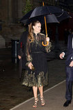Hilary Swank covered herself under an umbrella arriving at the Salvatore Ferragamo Resort collection show in Paris.