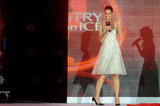 Katie Holmes wore a white dress on stage.
