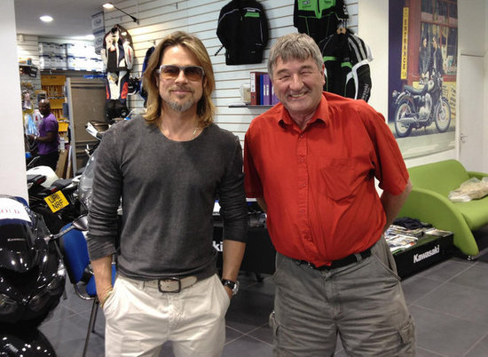 Brad Pitt posed with a staff member at a Honda motorcycle shop in London.