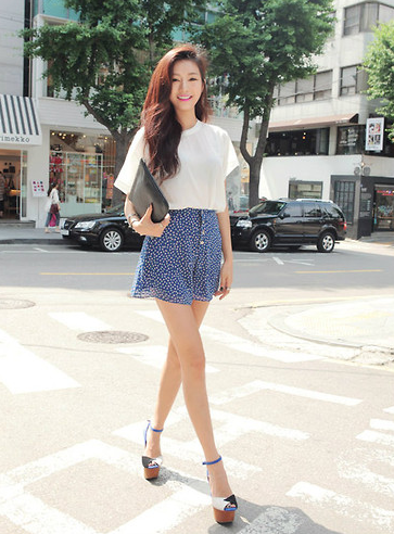Sweeten a white tee with seasonal bottoms and ankle-strap sandals.  Photo courtesy of Lookbook.nu