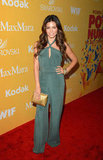 Jenna Dewan chose a Summer-feeling halter-neck jumpsuit in a cool green hue, then piled on an armful of colored crystal bangles and toted an exotic metallic clutch.