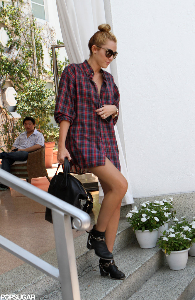 Miley Cyrus left her Miami hotel wearing her hair in a high bun.