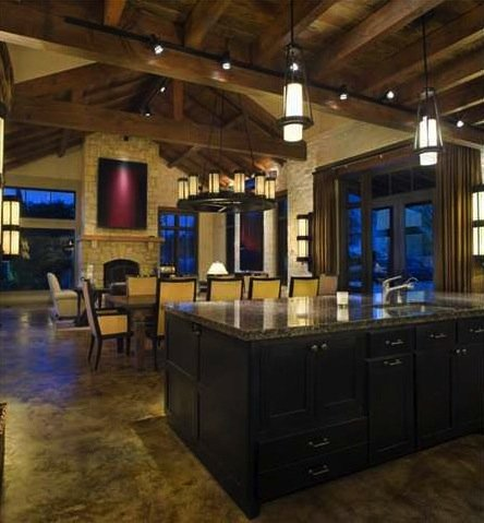 The house features lofted ceilings with incredible stone and beam work.
