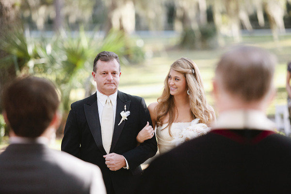The bride looked over at her dad during their walk down the aisle. Photo by Red Fly Studio via Style Me Pretty