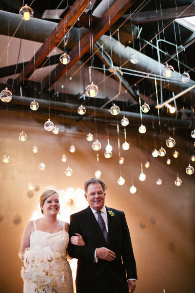 Dad and daughter were all smiles down the aisle. Photo by Melissa Schollaert Photography via Style Me Pretty