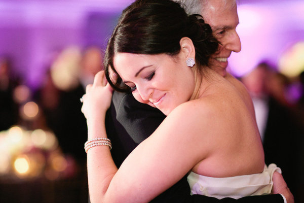 A bride squeezed her dad tight during the father/daughter dance. Photo by Erin Hearts Court via Style Me Pretty