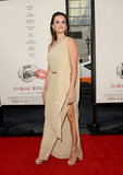 Penelope Cruz's legs were exposed under her Michael Kors gown with a large slit at the premiere of To Rome With Love in LA.