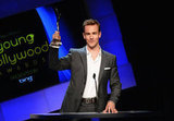 James Van Der Beek raised his trophy up as he thanked the crowd.