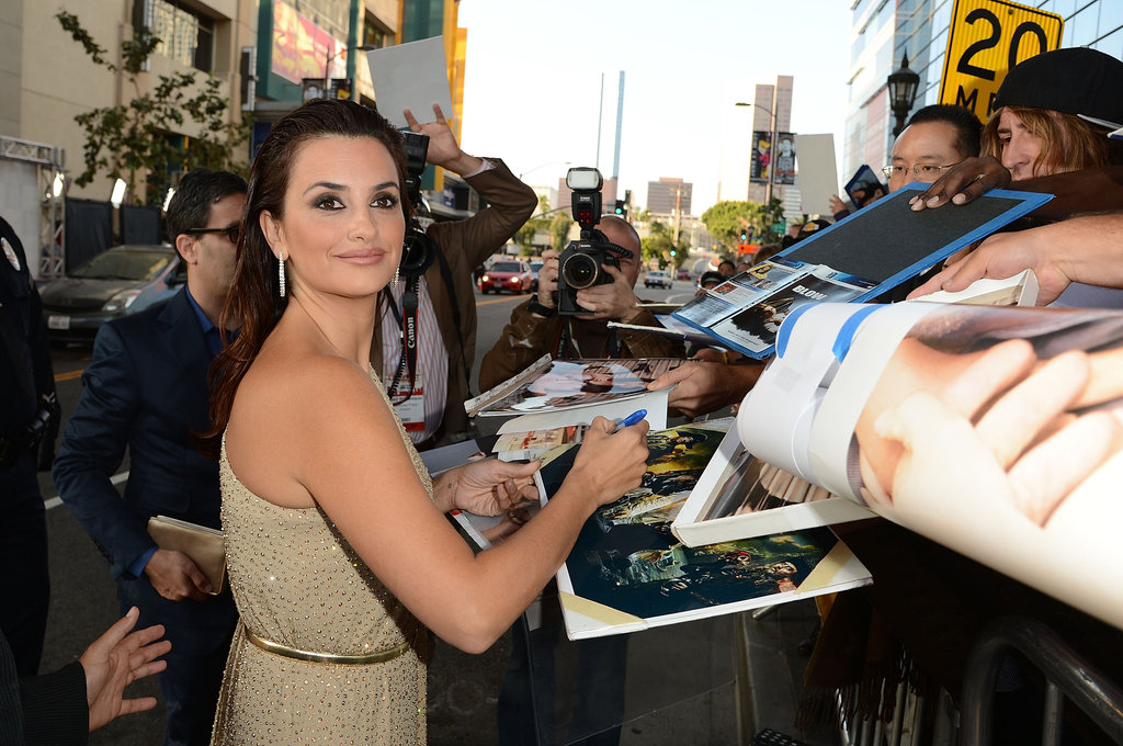 Penelope Cruz signed autographs at the premiere of To Rome With Love in LA.