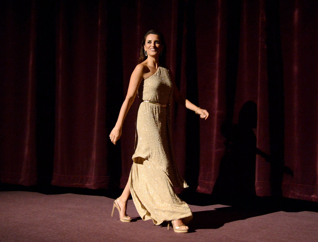 Penelope Cruz strode across the stage at the premiere of To Rome With Love in LA.
