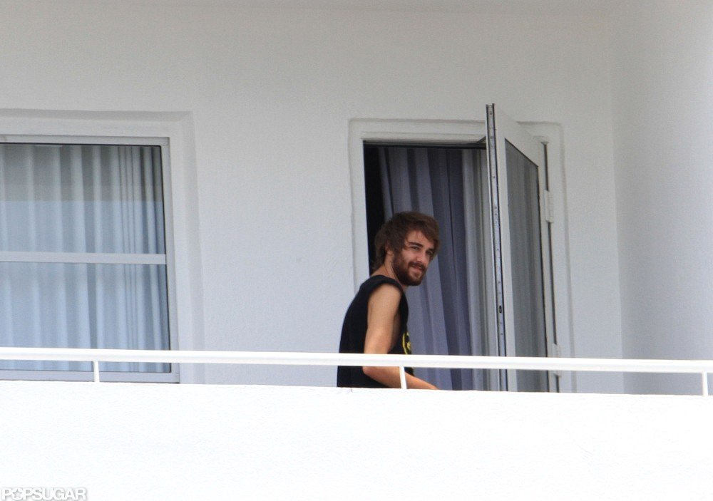 Cheyne Thomas hung out on Miley Cyrus's balcony in Miami.
