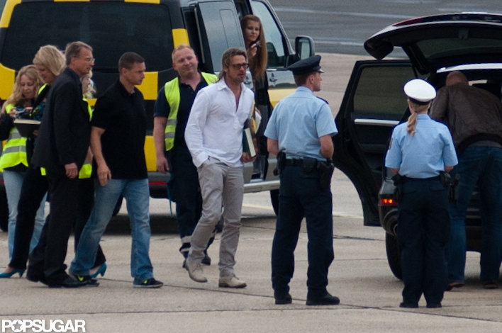 Brad Pitt walked to his waiting plane.
