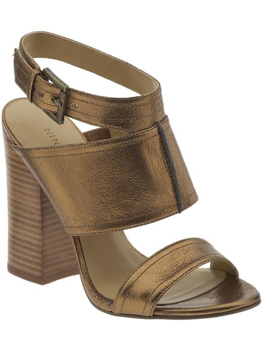 This bronzed version offers a muted take on the statement hue. The wood heels look fantastic with a little floral dress and blazer for the office.  Nine West Slipin Sandals ($89)