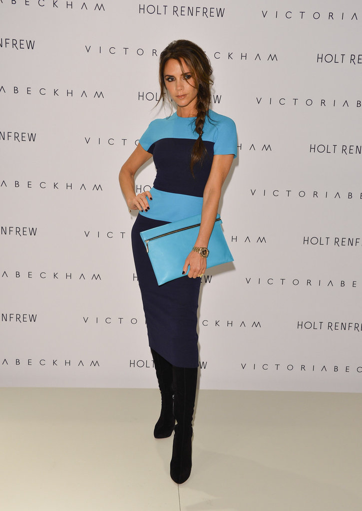 Always looking chic, Victoria Beckham wore a dress from her collection for her showing in Vancouver.