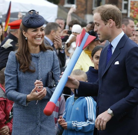 Kate Middleton and Prince William laughed while preparing to throw a foam toy during an event in June 2012.