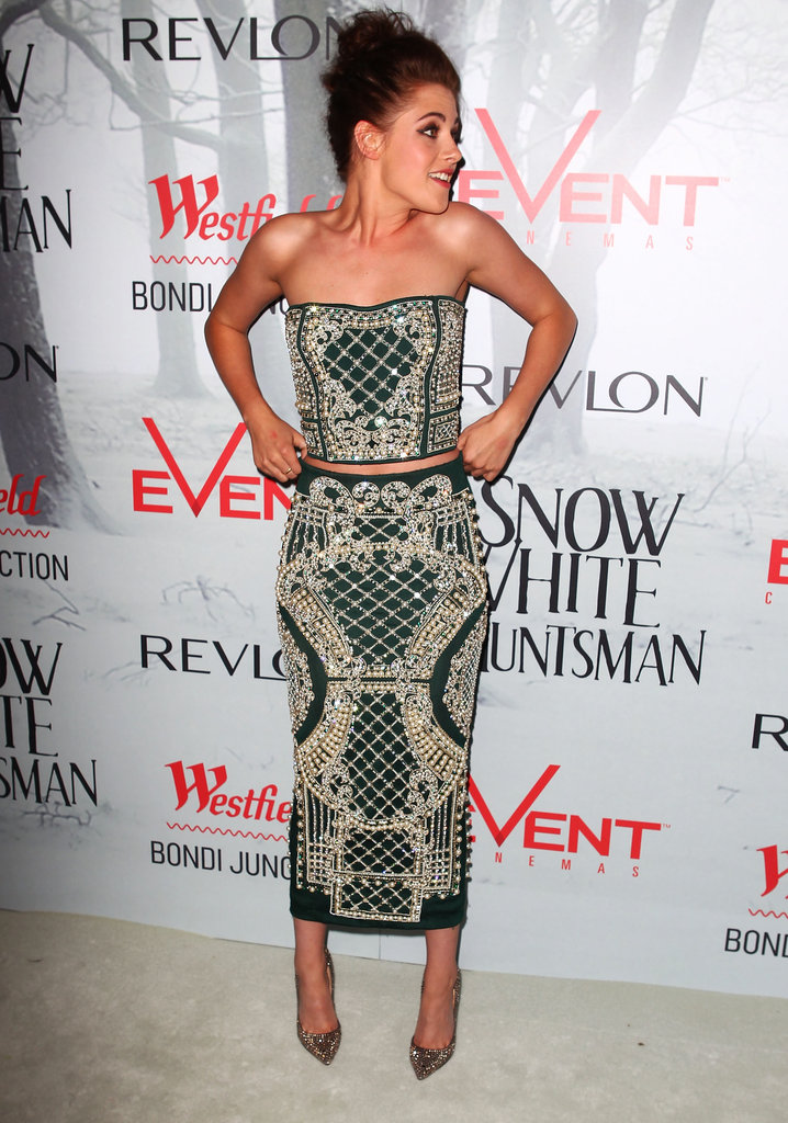 Kristen's Balmain two-piece ensemble lends a peek at Kristen's midriff.