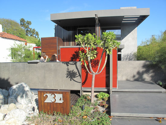 One of the eco features of the home is evident before you even walk in the door: the grass-less landscaping and use of water-efficient succulents.