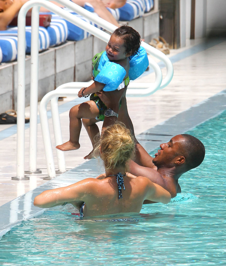 Doutzen Kroes and husband, Sunnery James, cooled off in the water with their son, Phyllon.