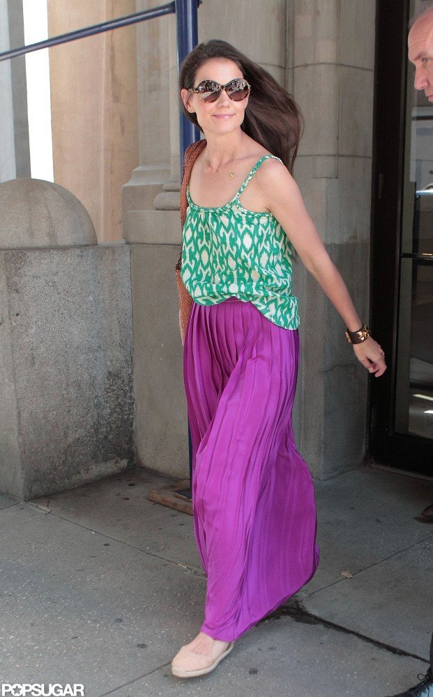 Katie Holmes left her NYC apartment smiling.