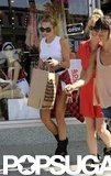 Miley Cyrus carried a bag full of new purchases after leaving American Apparel in LA.