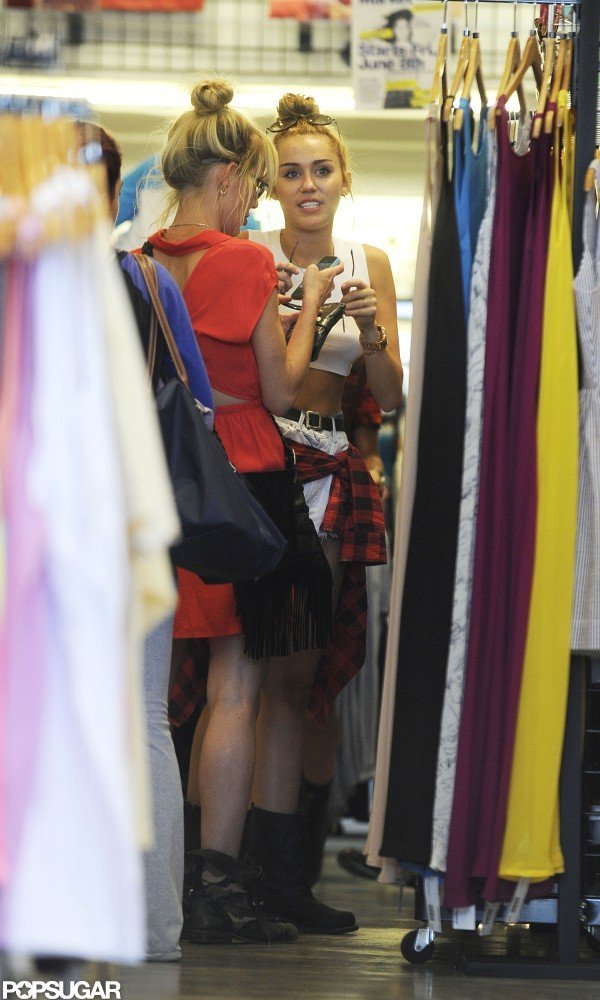 Miley Cyrus shopped and chatted with a friend in LA.