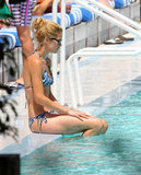 Doutzen Kroes cooled off in the water while visiting the pool in Miami.