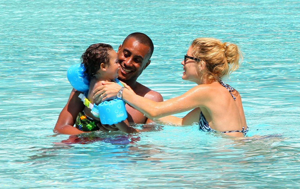 Doutzen Kroes and Sunnery James smiled as they taught their son, Phyllon, to swim.
