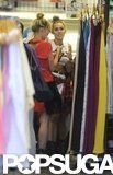 Miley Cyrus and a friend had matching hairstyles as they shopped together in LA.
