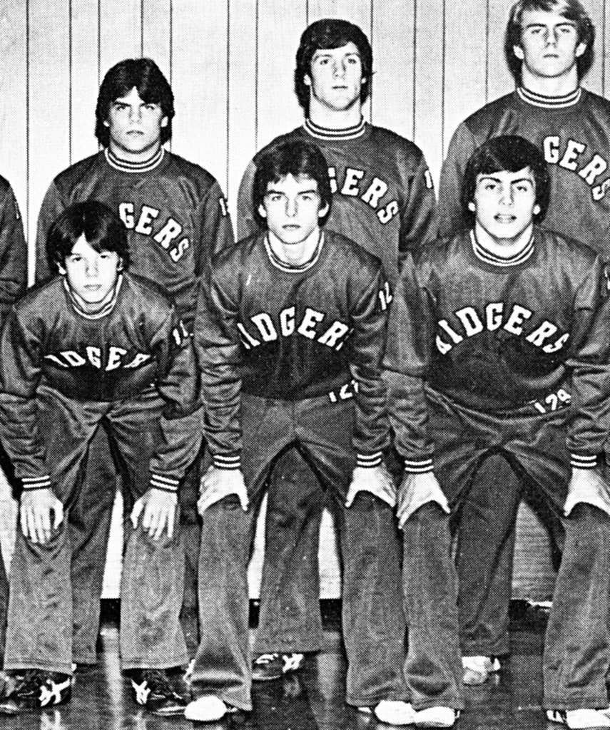 Tom Cruise, center bottom, posed with his high school wrestling team.