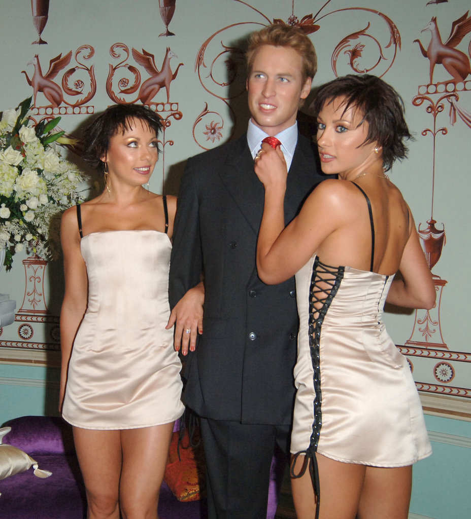 "Some scantily clad women known as ""the cheeky girls"" posed with William's waxwork during the Fabulous Gay Weddings Launch Party in London."