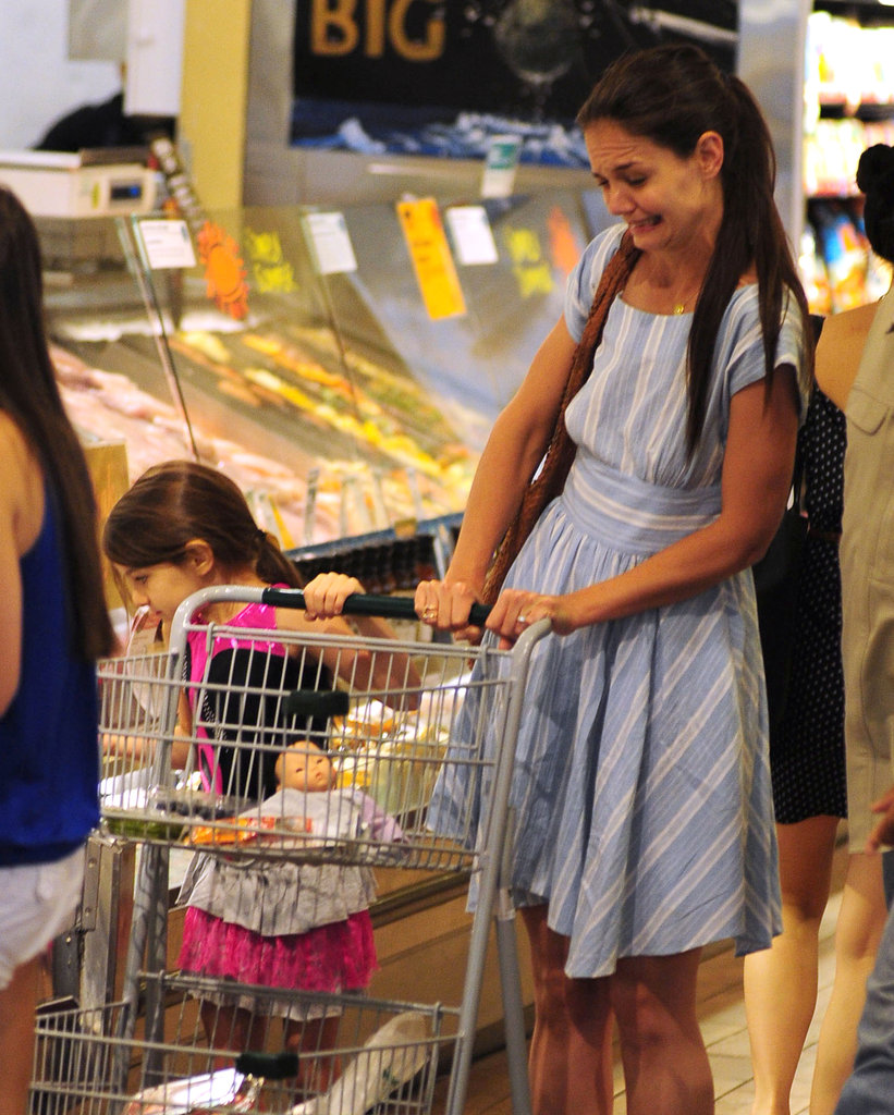 Katie Holmes made a funny face as Suri Cruise picked out some food items at Whole Foods in NYC.