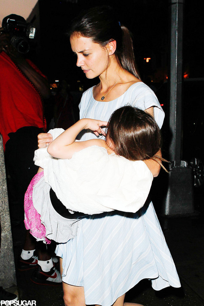 Katie Holmes carried a tired Suri Cruise in NYC.