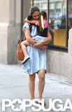 Katie Holmes carried Suri Cruise leaving Whole Foods in NYC.