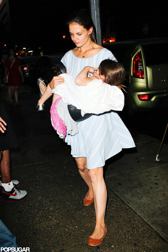 Katie Holmes carried Suri Cruise after a long day in NYC.
